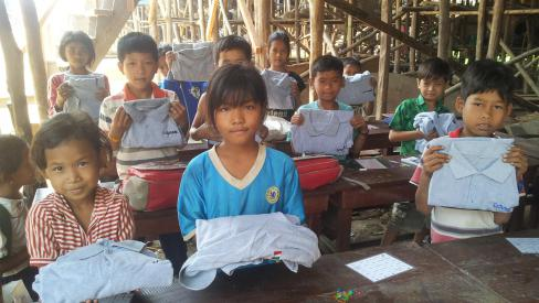 Coveme donates clothing  in Cambodia